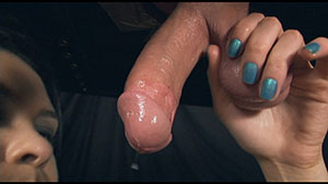 Gloryhole handjob video performed by Amo Morbia on a restrained cum filled cock featured on HandDomination.