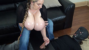 FemDom handjob video performed by busty April Mckenzie on a restrained cum filled cock featured on HandDomination.