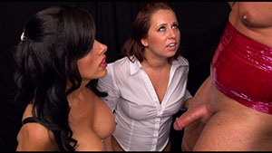 FemDom handjob video performed by 2 mean mistresses on a restrained cum filled cock featured on HandDomination.