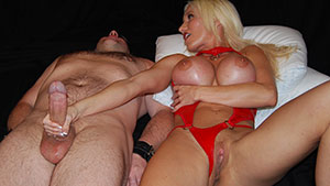 FemDom handjob video performed by Mistress Chambers on a restrained cum filled cock featured on HandDomination.