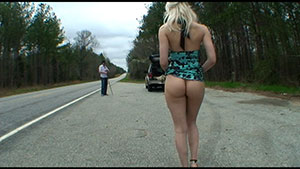 Public outdoor handjob video performed by Ashley Jane on a good samaritan featured on HandDomination.