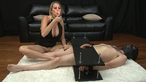 FemDom handjob video performed by Dallas Diamondz on a restrained cum filled cock featured on HandDomination.