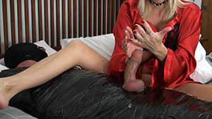 FemDom handjob video performed by sadistic blonde MILF Dallas Diamondz on a mummy cum filled cock featured on HandDomination.