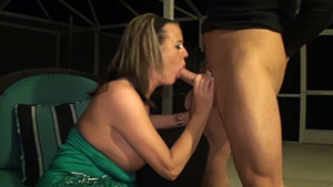 Cuckold blowjob video performed by disrespectful busty MILF Grace Evangeline on a young cum filled cock featured on HandDomination.