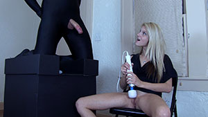 FemDom handjob video performed by Hope Harper on a restrained cum filled cock featured on HandDomination.