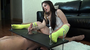 FemDom handjob video performed by Nikki Charm on a restrained cum filled cock featured on HandDomination.