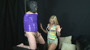 FemDom handjob video performed by Shelby Paige on a restrained cum filled cock featured on HandDomination.