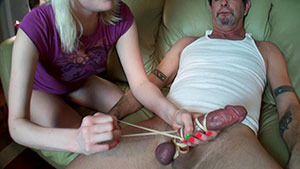Sadistic blonde FemDom handjob video performed by Tina Marie on an elderly cum filled cock featured on HandDomination.